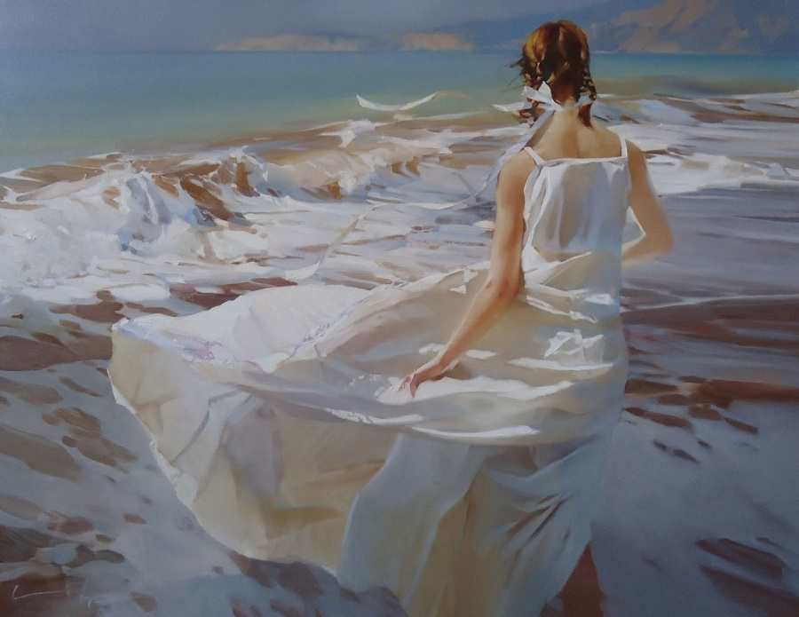En robe de mariée face à la mer
